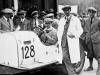 Mille Miglia, Brescia in Italien, 12. bis 13. April 1930. Mercedes-Benz Typ SSK (W 06) bei der Abnahme. Startnummer 128 – das Siegerteam Rudolf Caracciola / Christian Werner (rechts am Wagen).